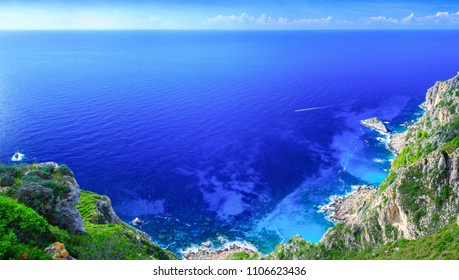 Beautiful summer panoramic seascape. Awesome view of the coastline Kastelli beach into the sea bay with crystal clear azure water. Outskirts Paleokastrica. Corfu. Ionian archipelago. Greece.