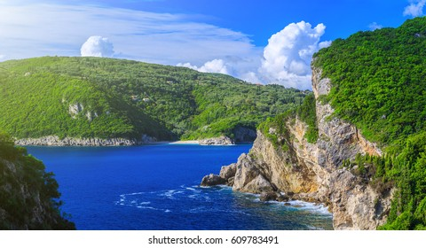 Beautiful summer panoramic seascape. View of the coastline into the sea bays with crystal clear azure water. Paleokastrica. Corfu. Greece.