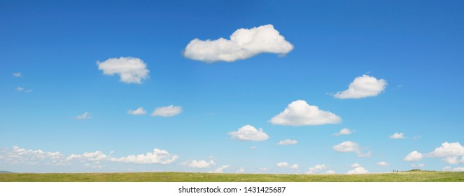 Beautiful summer panoramic view of cloudscape and blue sky over green valley