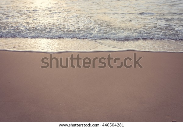 beautiful summer sand beach and sea surf, image used vintage filter
