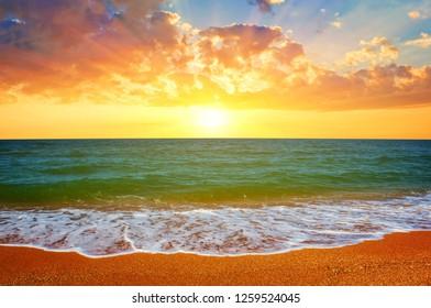 beautiful summer sandy sea beach scene at the sunset