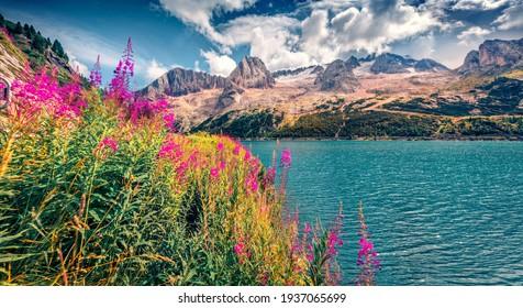 Beautiful summer scenery. Charming morning view of Fedaia lake. Stunning summer scene of Dolomiti Alps, Gran Poz location, Trentino-Alto Adige, Sudtirol region, Italy, Europe.