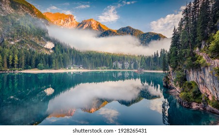 Beautiful summer scenery. Foggy morning view of Braies (Pragser Wildsee) lake. Splendid summer scene of Fanes-Sennes-Braies national park, Dolomiti Alps, South Tyrol, Italy, Europe.