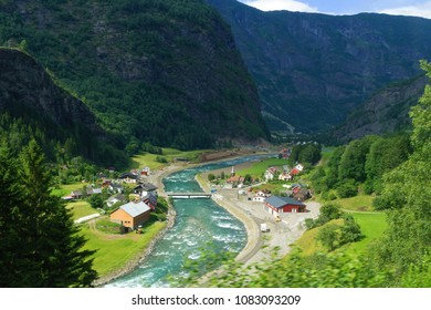 Beautiful summer scenic of small village by the river in the valley from The Flam Railway, the most beautiful train jurney in the world from Flam to Myrdal, Norway.