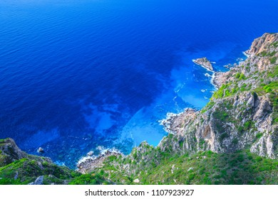 Beautiful summer seascape. Awesome view of the picturesque green hill coastline sea bay with crystal clear azure water in the calm warm Mediterranean sea. Outskirts Paleokastrica. Corfu. Greece.