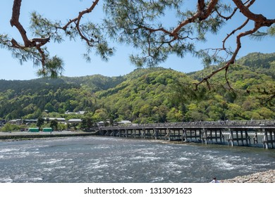 Beautiful summer season Togetsu-kyo Bridge is a landmark in Arashiyama District which is wooden bridge cross over Katsura River at Kyoto, Japan
