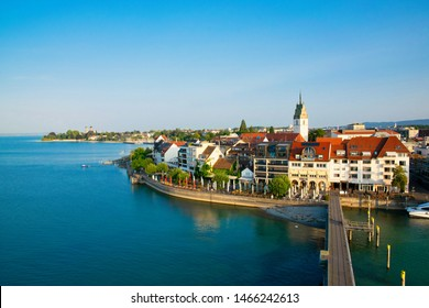 Beautiful summer sunrise on Bodensee in Germany with a view to Friedrichshafen city from best viewpoint Moleturm