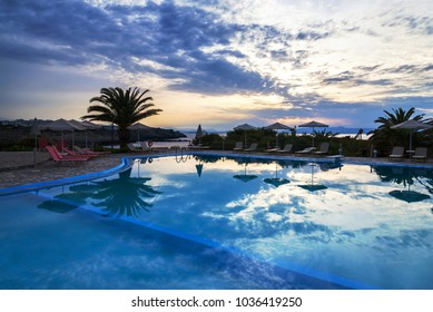 beautiful summer sunset by the swimming pool