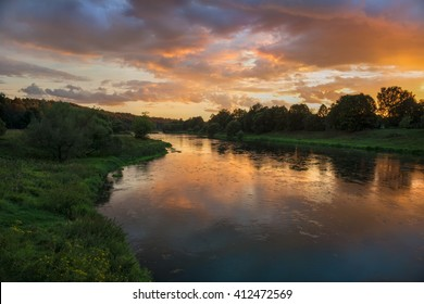 Beautiful summer sunset in the river