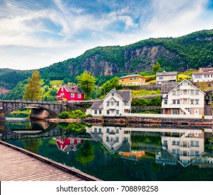 Beautiful summer view of Norheimsund village, located on the northern side of the Hardangerfjord. Colorful morning scene in Norway, Europe. Traveling concept background.