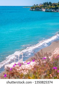 Beautiful summer view over white cliffs and turquoise blue water sea at Governor's Beach near Limassol, Cyprus.