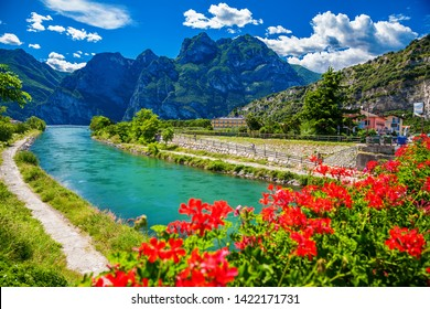 beautiful summer view of the Sarca river in a small town Torbole on the lake Garda, Italy