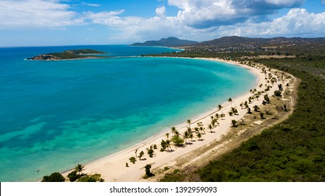 Beautiful Sun Bay beach with small fishing boats and people relaxing located on the tropical Caribbean island of Vieques Puerto Rico