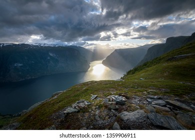 Beautiful sun beam in the Aurlandfjord from Prest viewpoint in stunning mountain scenery Norway - Shutterstock ID 1359906911