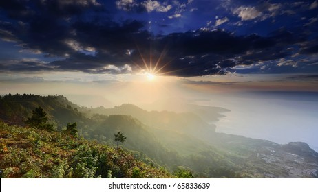 beautiful sun on the lake toba Lake Toba is the second largest lake in Southeast Asia,, located in North Sumatra,indonesia