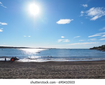 Beautiful sun over nostalgic scenery on a beach in Norway at early morning