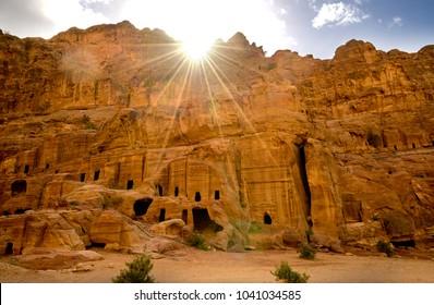 Beautiful sun rays above the tomb on street of facades petra, Jordan