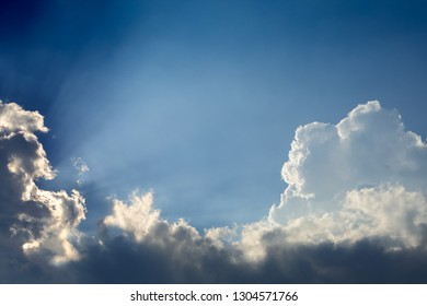 beautiful sun rays through cloud above clear blue heaven sky, sunlight in the summer day