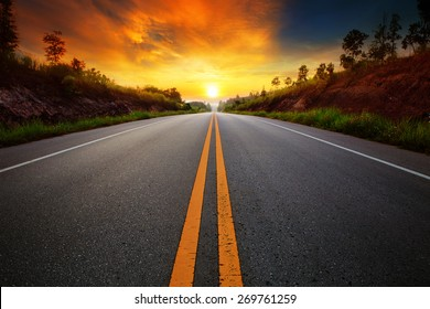 beautiful sun rising sky with asphalt highways road in rural scene use land transport and traveling background,backdrop - Shutterstock ID 269761259