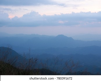 Beautiful sun set sky with layers of mountains at Doi Tu Lay (Tu Lay Mountain), Tak province, Thailand