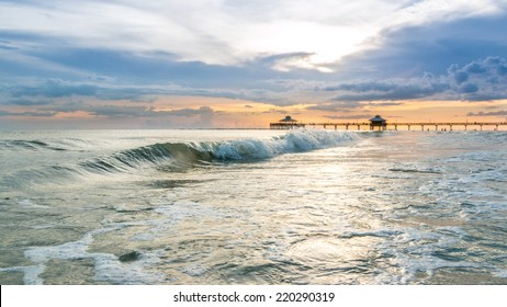 The beautiful sun setting on the shores of Fort Myers Beach located on Estero Island in Florida, United States of America