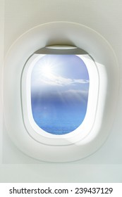 beautiful sun shining over clear blue ocean through  frame of windows plane  use as background,backdrop