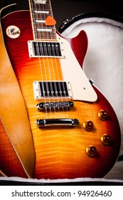 Beautiful Sunburst Electric Guitar Standing Up Inside a Hard Shell Electric Guitar Case