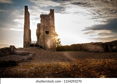 Beautiful sunburst on an autumn day on Brough Castle ruins in Cumbria, England UK.