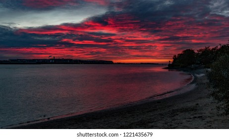 beautiful sundown, sunset, red sky over the water