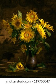 Beautiful sunflowers in a vase on dark wood background