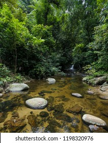 A beautiful Sungai Ruok waterfall in peace nature environment of 130 million years old Royal Belum Rainforest Park at Temengor Lake.