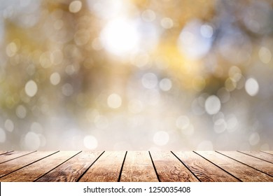 Beautiful sunlight in the woods with a wooden plank floor