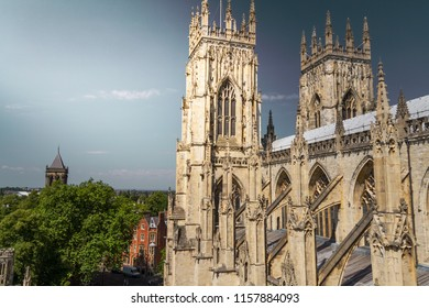 Beautiful sunlit view of the spires of York Minster Cathedral with the town in sight in Yorkshire, England UK.