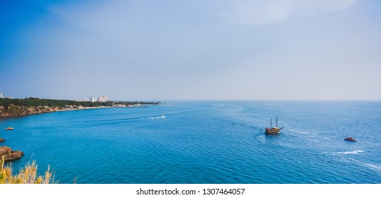 Beautiful sunny aerial view of Turkish marine landscape. Antalya city. Sailing boats in calm blue sea water. Horizontal color photography.