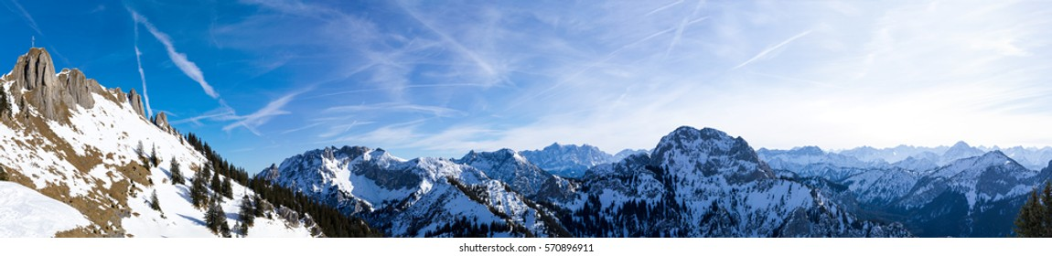 Beautiful, sunny, alpine winter panorama as seen from the Tegelberg massive, including the Branderschrofen on the left and Germany's highest mountain, the Zugspitze, back in the center.