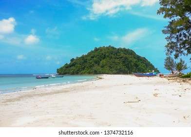Beautiful sunny beach coastline with sandy beach in Kulambu island,Kudat,Sabah,Malaysia.Kulambu Island is connect to the mainland by a stretch of sand bar.
