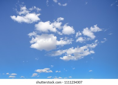 Beautiful sunny day - Blue sky with puffy clouds.
