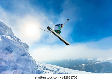 Beautiful sunny day in the mountains, winter, skier