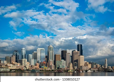 Beautiful Sunny Day in Seattle, Washington. The Seattle skyline as seen from the Bainbridge Island ferry. Puffy clouds and blue sky make for a perfect day in the Puget Sound area.