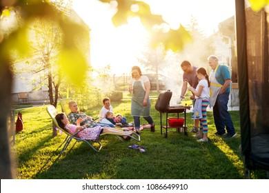 It was a beautiful sunny day when big family gathered on a picnic in a field.