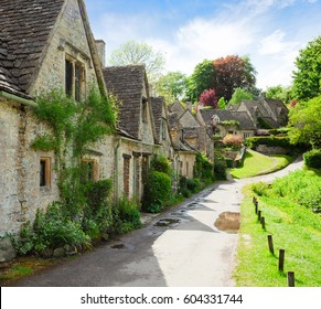 A beautiful sunny morning in  Bibury,  Gloucestershire,  England, UK.  Old street with traditional cottages