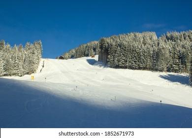 Beautiful sunny morning over empty ski slope in Filzmoos, Salzburg county (Austria) - Shutterstock ID 1852671973