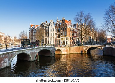 Beautiful sunny winter view on one of the Unesco world heritage city canals of Amsterdam, The Netherlands.