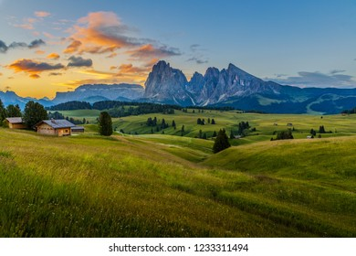 Beautiful sunrise at Alpe di siusi (Seiser Alm) with langkofel mountain in Dolomites, Italy