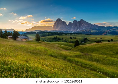 Beautiful sunrise at Alpe di siusi (Seiser Alm) with langkofel mountain in Dolomites, Italy.