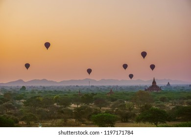 A beautiful sunrise with balloons floating in the air in Bagan - city of thousands of Buddhist pagodas. Myanmar