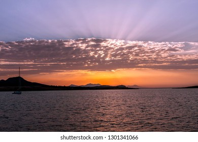 Beautiful sunrise in a bay on a quiet mediterranean sea in Greece, September 2016