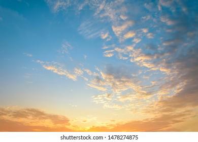 Beautiful sunrise. Blue and orange sky with dramatic clouds.