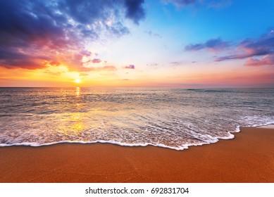 Beautiful sunrise and blue sky by the beach.