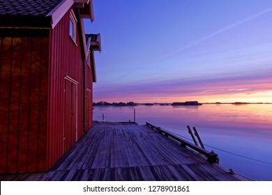 Beautiful sunrise by norwegian boat houses